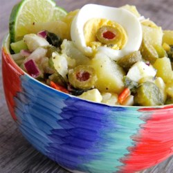 Yucatan Potato Salad Recipe - This is not your regular potato salad. Potatoes are combined with roasted peppers, olives, onion and sweet pickle in a lime dressing. Try this when you want to be a little different.