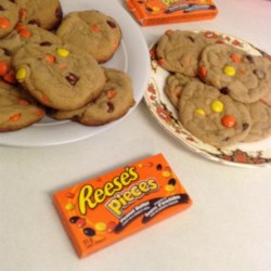 Chocolate Halloween Cookies Recipe - Rich chocolate cookies are loaded with candy-coated peanut butter pieces and topped with homemade chocolate frosting for a festive Halloween treat.