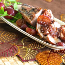 Pork Tenderloin with a Honey Grape Sauce Recipe - Simple preparation with an exotic taste. Grilled pork tenderloin served with a sauce made with shallots, garlic, honey, grapes, and ginger.