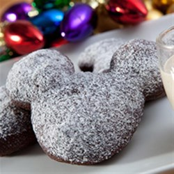 Gingerbread Beignets with Eggnog Creme Anglaise Recipe - Classic treats from New Orleans--puffy spiced deep-fried beignet dough dusted with cinnamon-sugar--are served with a creamy dipping sauce.