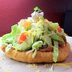 Fry Bread Tacos II Recipe - A yummy twist to an old favorite.  The frybread makes the difference.  It's a popular request at my house.  I do up everything but the frybread in advance, and just heat up before serving. Leftover frybread can be used as dessert - coat it with cinnamon and sugar, and drizzle with honey.