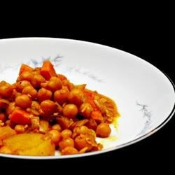 Chickpea Curry Recipe - Chickpeas are simmered in a fragrantly spiced curry sauce mixture and garnished with fresh cilantro.