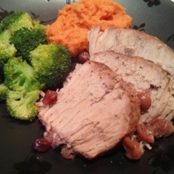 Slow Cooker Cranberry and Muscadine Pork Roast Recipe - This recipe reveals an easy way to make a tender, juicy pork roast in the slow cooker with muscadine wine, cranberries, and garlic.