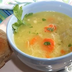 Chicken Soup III Recipe - A whole chicken is simmered for hours with vegetables, bouillon cubes and celery seed, then the stock is strained and it and the cooked chicken are combined with vegetables and rice for a soup like mom used to make.