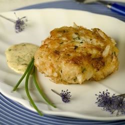 Crab Cakes III Recipe - Crab cakes seasoned with lemon zest and fresh basil, pan fried and served with a seasoned cilantro-lime sauce.