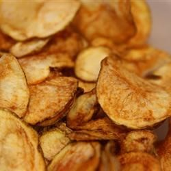 "Homestyle Potato Chips Recipe - ""Making homestyle potato chips is fun and easy. Guaranteed they won't last long! A food processor with a slicing attachment is very helpful. Experiment with the thickness; you may like them thicker or thinner."""