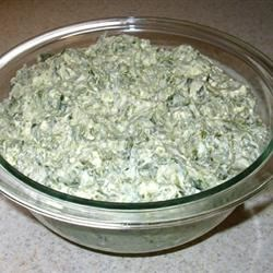 Creamy Spinach Dip Recipe - A very yummy and creamy dip that's great for parties.  Serve with crackers, tortilla chips or pita bread. Scallions may be used in place of diced onion.