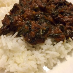 Easy Indian Curried Lamb Recipe - Tender lamb meat is simmered in an Indian-inspired curry sauce for a delicious and warming meal. Serve with rice.