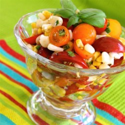 Tomato, Basil, and Corn Salad with Apple Cider Dressing Recipe - Fresh tomato, basil, and corn salad tossed in a simple apple cider dressing is a refreshing salad to make anytime of the year.