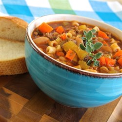 MeMe's Pasta Fagioli Recipe - Cannellini beans, ground beef, and ditalini are simmered in a vegetable juice-based broth creating pasta fagioli similar to the famous Italian restaurant chain.