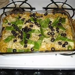 Baked Spaghetti III Recipe - Spaghetti is baked in an onion tomato sauce flavored with cumin and thyme.
