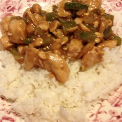 Cashew Chicken II Recipe - Diced chicken simmered with the Asian flavors of soy sauce, bamboo shoots and water chestnuts and topped with cashews, of course! This is a delicious and easy recipe, perfect for families on the go, like mine.