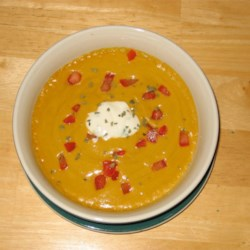 Spicy Sweet Potato Soup Recipe - Sweet potato soup warmly spiced and beautifully presented. Use creme fraiche if available in place of the sour cream.