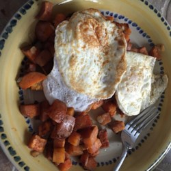 Savory Sweet Potato Hash Recipe - Diced sweet potatoes and ham are pan-fried with a touch of cinnamon and cayenne pepper for a sweet and savory hash that is a  perfect accompaniment to scrambled eggs.