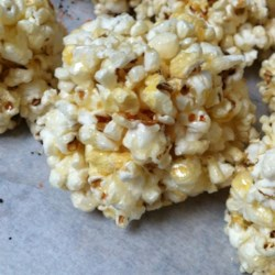 Grandpa's Popcorn Balls Recipe - Great, Great Grandpa Apell had a huge farm in Illinois with prize-winning corn.  He made Popcorn Balls for all the Grandkids at Christmastime. He lived to be 106 and claimed workin' the farm and eatin' corn was the secret! This recipe is delicious!