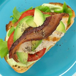 Chicken BLT by Avocados From Mexico Recipe - Grilled chicken breast, lettuce, tomato, and slices of avocado and bacon are layered on toasted Tuscan bread with a creamy basil aioli.