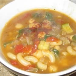 Garbanzo Tomato Pasta Soup Recipe - A VERY easy vegetarian meal in a bowl.  The combination of garbanzo beans (chick peas) with pasta creates the complex proteins a vegetarian needs. Very palatable for the garlic and tomato lover.