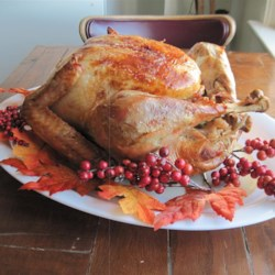 Perfect Turkey Recipe - A brine makes this roasted turkey extra moist and flavorful. Stuffed with vegetables, this bird is perfect for Thanksgiving and other holidays.