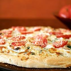 Pizza Crust I Recipe - Your bread machine prepares this classic dough, with olive oil lending an authenticity to the chewy crust. Just pat this great dough into your pizza pan and you are on your way to a Mediterranean experience.
