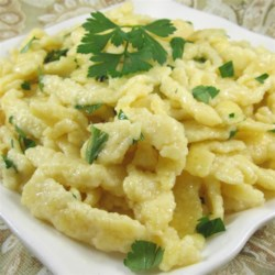 German Spaetzle Dumplings Recipe - A traditional German dumpling or noodle, spaetzle is boiled in water or broth then pan fried in butter and served as a side dish.
