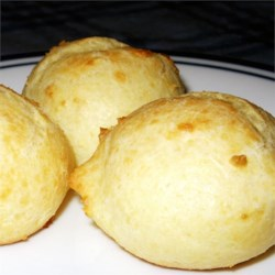 Parmesan Puffs Recipe - Parmesan cheese dough drops are baked into puffy little appetizer balls and dipped in warm marinara sauce.
