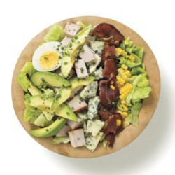 Cobb Salad by Avocados From Mexico Recipe - This green salad is a meal in itself with smoked turkey, blue cheese, avocado slices--and more--tossed with Champagne vinaigrette.