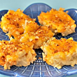Spicy Cauliflower Bites Recipe - Roasted and mashed cauliflower portions are topped with cheese and red pepper in this recipe that produces tasty cauliflower bites with a kick.