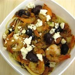 Shrimp with Tomatoes and Feta Cheese Recipe - Shrimp cooked in a tomato jalapeno sauce and sprinkled with feta cheese.