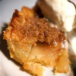 Apple Crumb Pie Recipe - Sliced apples, raisins and walnuts are sugared, dusted with cinnamon and nutmeg, and piled into a pastry shell. A sweet crumbly topping is sprinkled over the top. The whole pie is then loosely covered with aluminum foil, and baked until golden and brown.