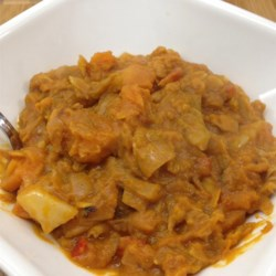 Vegan African Stew Recipe - This stew recipe uses peanut butter, apple juice, and tomatoes to flavor the abundance of yams, cabbage, onion, and bell pepper stewing within.