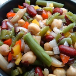 Three Bean Salad I Recipe - This peppy bean salad is a colorful mix of green, yellow wax, red kidney, garbanzo, and black beans, perked up by a dressing with mustard, cilantro and tarragon.