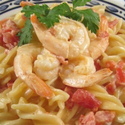 Bay Shrimp and Cream Sauce Recipe - Prepare this recipe for a creamy sauce with bay shrimp and tomatoes to serve over pasta or seafood fillets.