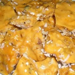 Coconut Brittle Recipe - Microwave brittle candy with macadamia nuts and a coconut layer.