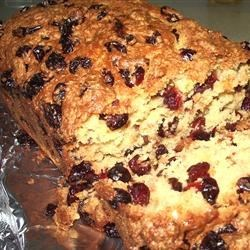 Grandmother's Famous Cranberry Bread Recipe - Raisins are cranberries are baked into this orange scented loaf.  This would be an ideal hostess gift, or simply enjoyed with afternoon tea.