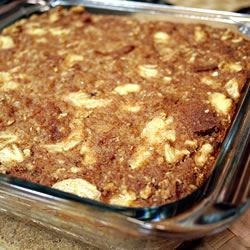 Banana Oat Bread Pudding Recipe - Whole wheat bread and oats steep in milk, then bake together with bananas, raisins and brown sugar for a sweet, wholesome dessert.