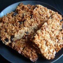 English Flapjack Recipe - An English recipe. Brown sugar and oat cakes with raisins. Very easy to make, and very delicious. Good for lunch-boxes too.