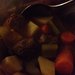 Vegetable Beef Soup III Recipe - Beef stew meat is slowly simmered with tomato-vegetable juice cocktail, onion, chili powder and Worcestershire and then potatoes, carrots and celery are added at the end and cooked until just tender.