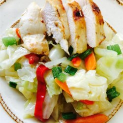Jamaican Cabbage Recipe - A side dish of cabbage and carrots with a sweet, spicy kick of vinegar and hot chile pepper makes a great accompaniment for jerk chicken or pork.