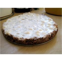 Sarah Contona's Sweet Potato Pie Recipe - Melted marshmallows top a creamy sweet potato filling in a sweet graham cracker crust. This pie can be prepared the night before the dinner without the marshmallows. Reheat the pie and melt the marshmallows on top just before serving!