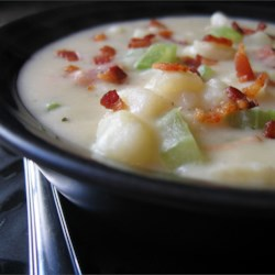 Absolutely Ultimate Potato Soup Recipe and Video - This easy potato soup is made with chicken stock, bacon, onion, celery, and herbs, then finished with a little cream for extra richness.