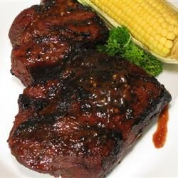 BBQ Chuck Roast Recipe - A barbecued chuck roast, marinated in a tangy sauce featuring beer, ginger, and teriyaki and barbeque sauces, and cooked on a spit.