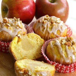 Applesauce-Filled Cupcakes Recipe - Easy cinnamon-flavored, applesauce-filled cupcakes are drizzled with cinnamon icing and garnished with chopped pecans for a pretty autumn treat.