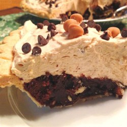 Peanut Butter Pie Surprise Recipe - Brownies are baked in a pie shell then topped with a creamy peanut butter layer and sprinkled with chopped peanuts and chocolate chips.