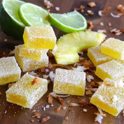 Pina Colada Fruit Jellies Recipe - Fruit jellies are a simple and sweet treat, but when you give them a pina colada flavor, you just might find them addicting.