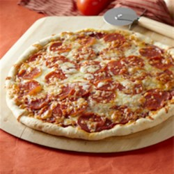 Homemade Pepperoni Pizza Recipe - Making your own homemade pizza crust and tomato sauce is easier than you might think--and this recipe for pepperoni pizza produces a delicious classic.