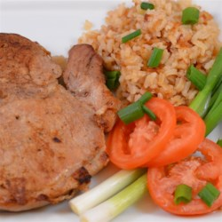 Baked Pork Chops and Rice Recipe - Baked pork chops with rice is an easy one-dish meal with plenty of flavor from caramelized onion mixed into the rice.