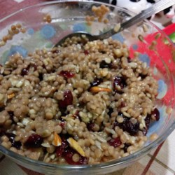 Israeli Couscous with Cranberries, Walnuts, and Sunflower Seeds Recipe - A simple dressing of cider vinegar and maple syrup dresses a mixture of couscous, walnuts, sunflower seeds, almonds, and cranberries in this recipe.
