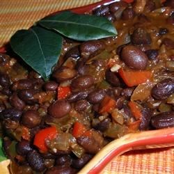 Cuban Black Beans I Recipe - We like these over rice. But they 'd be great all by themselves. Lots of black beans, spices, a splash of balsamic vinegar and other good things are plopped into a pot and simmered until it smells so good, you can 't stand it.