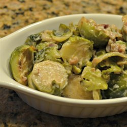 Brussels Sprouts with Sour Cream Recipe - Steamed Brussels sprouts make a beautiful and tasty side dish with sour cream and bacon bits.