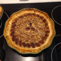 Old-Fashioned Honey Pecan Pie Recipe - There 's lots of honey and pecans in this pie. Honey is heated on the stovetop until bubbly, and then chopped pecans, butter, eggs, vanilla and nutmeg are stirred in. This thick, luscious filling is poured into a prepared pie crust and baked in the oven until set.
